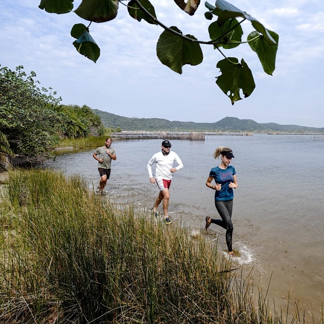 Trail running along the shores of the Kosi bay lake system.